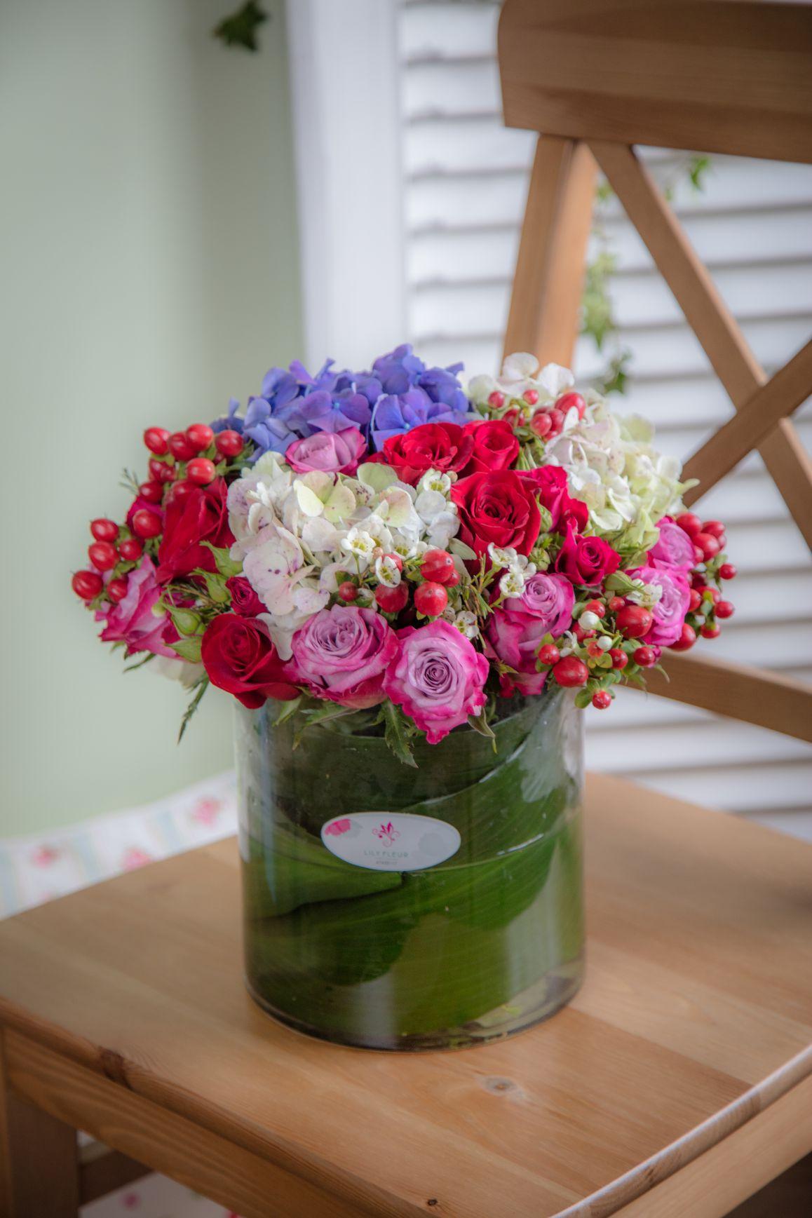 جويفل لي لي 'زهور مع قاعدة'